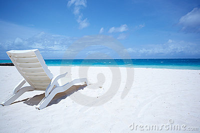 Lounge chairs tropical beach