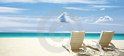 Lounge chairs tropical beach