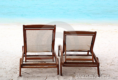 Lounge chairs on a tropical beach