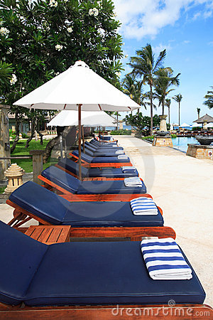 Lounge chairs umbrellas