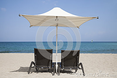Loungers with parasol