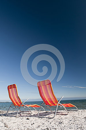 Beach Chairs on Lake Shoreline