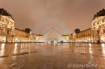 The Louvre Museum at the rainy night Editorial Stock Photo