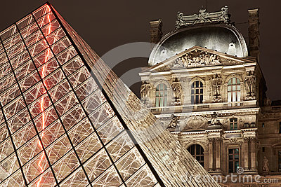 Louvre pyramid and museum night view in Paris Editorial Stock Photo
