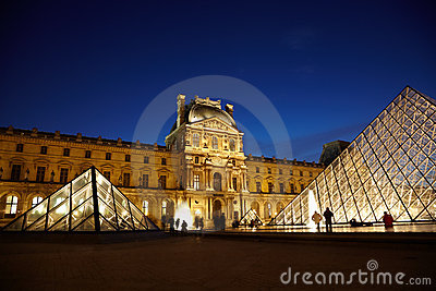 Louvre Pyramid and Pavillon Denon in evening Editorial Stock Photo