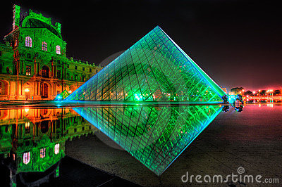 Louvre Pyramid shines at night Editorial Image