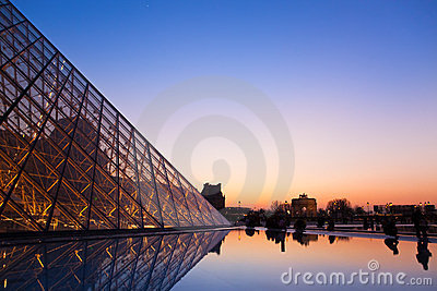 Louvre Pyramid and a view on a Tuileri garden Editorial Photography