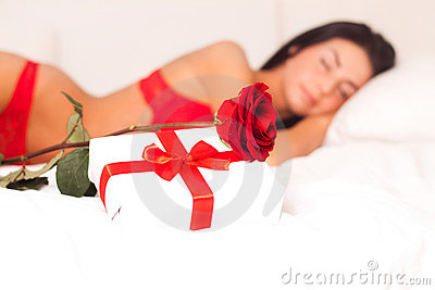 In love with a beautiful young girl lying in bed,