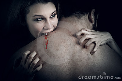 Love and blood - vampire woman biting her lover