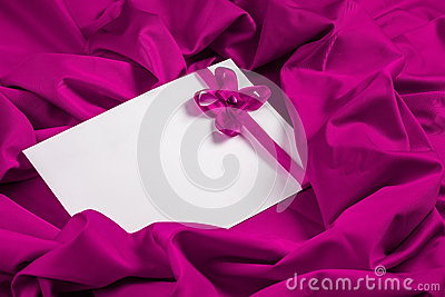 Love card with heart and ribbon on a purple fabric