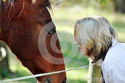 Love and care between lady and pet horse Stock Photo