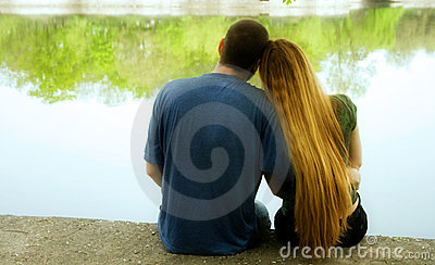 Love concept - two lovers hugging near park lake