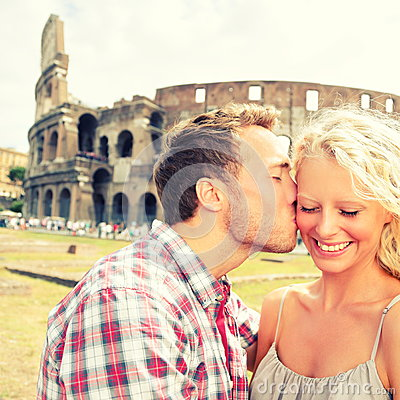 Love - Couple kissing fun in Rome by Colosseum