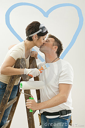 Love couple kissing in new home