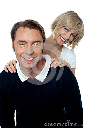 Love couple posing casually in front of camera