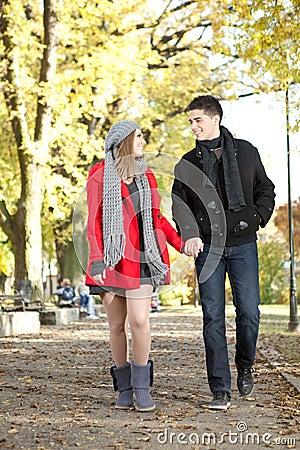Love couple walking in park