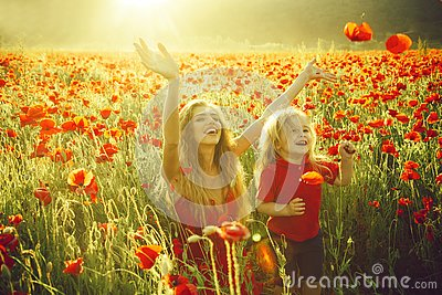Love and family, happy mother and child in poppy field Stock Photo