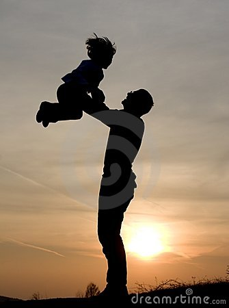 Love of father and child in sunset