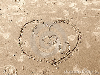 Love heart drawn on sand