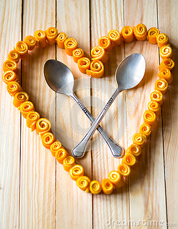 Free Love Heart From Orange Peels With Crossed Spoons Royalty Free Stock Photos - 30466818