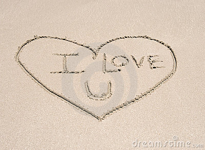 Love heart symbol in sand on tropical beach