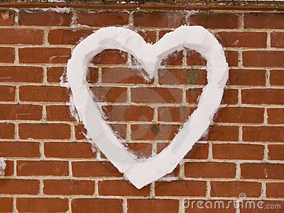 Love Heart on wall made from snow
