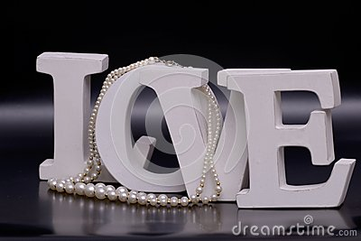love letters and pearl necklace