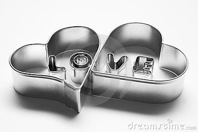 Love message in two hearts. Made of chrome letters