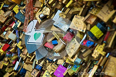 Love padlocks in a bridge over the Seine river in Paris Editorial Photo