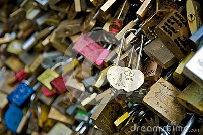 Love padlocks in a bridge over the Seine river in Paris Editorial Stock Photo