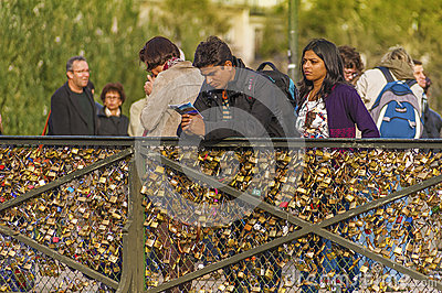 Love padlocks on Paris bridge Editorial Stock Photo