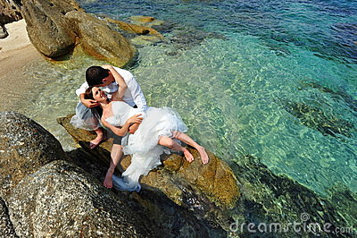 Love and passion - bride & groom - tropical scene