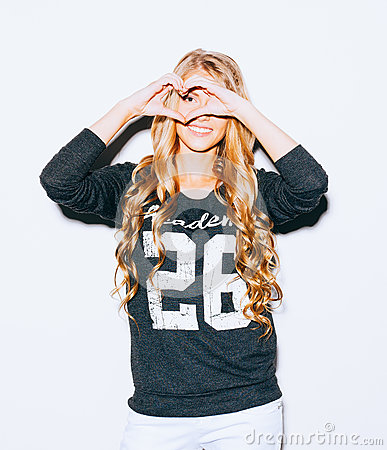 Free Love. Portrait Smiling Happy Young Woman With Long Blond Hair, Making Heart Sign, Symbol With Hands White Wall Background. Positiv Royalty Free Stock Photos - 68464138