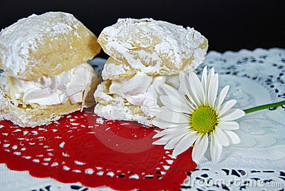cream filled puff pastry on red heart