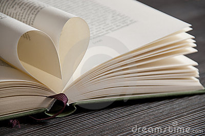Love reading - book pages forming heart shape