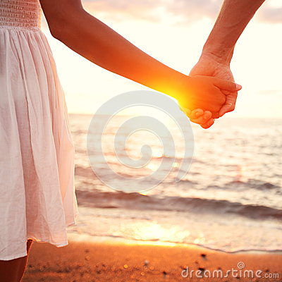 Free Love - Romantic Couple Holding Hands, Beach Sunset Stock Image - 32841651