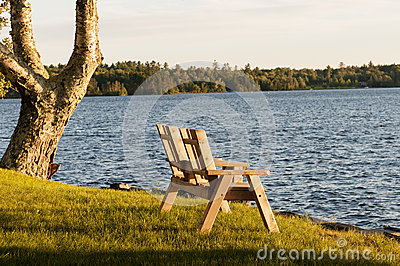 Love seat at lake in fall