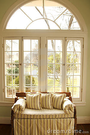 Love seat in window