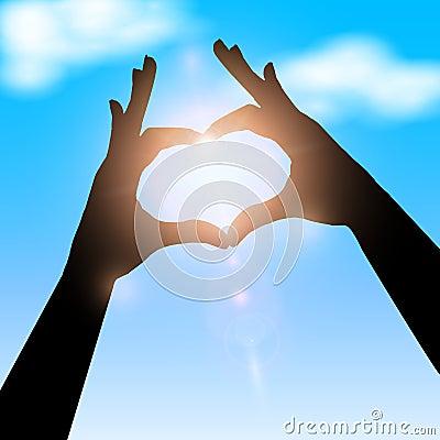 Love shape hand silhouette in sky.