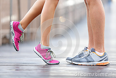 Love sport concept - running couple kissing