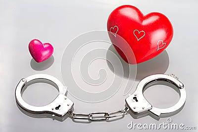 Love symbol in handcuffs