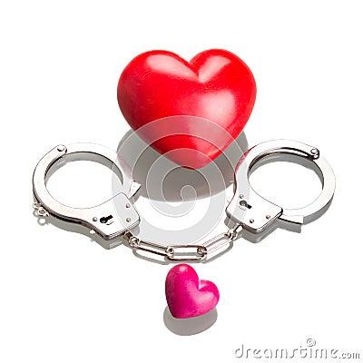 Love symbol in handcuffs over white