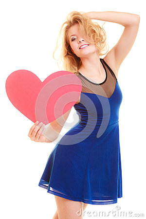 Love symbol. woman holds big red heart Stock Photo