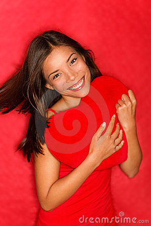 Love woman showing red heart
