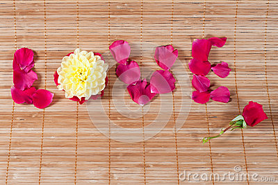 Love word written with flower petals