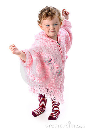 Lovely baby girl dancing in pink poncho isolated