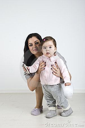 Lovely baby girl with her mother