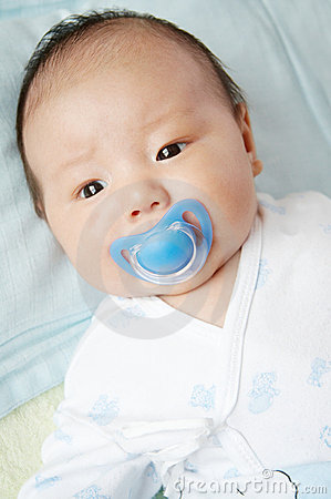 Lovely baby with pacifier