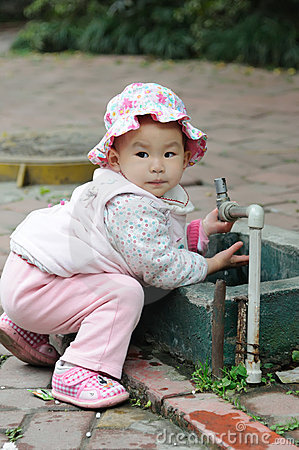 Lovely baby washing hand.