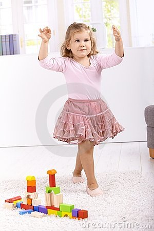 Lovely ballerina playing at home